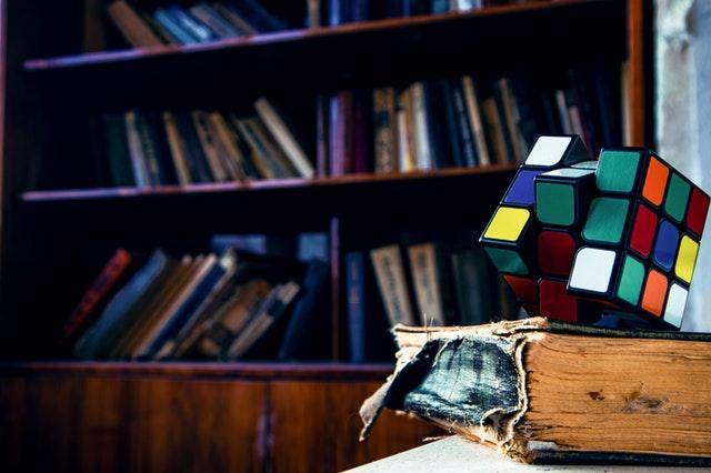 rubik-s-cube-on-book-2873277